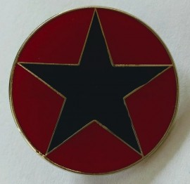 Black star on red enamel badge